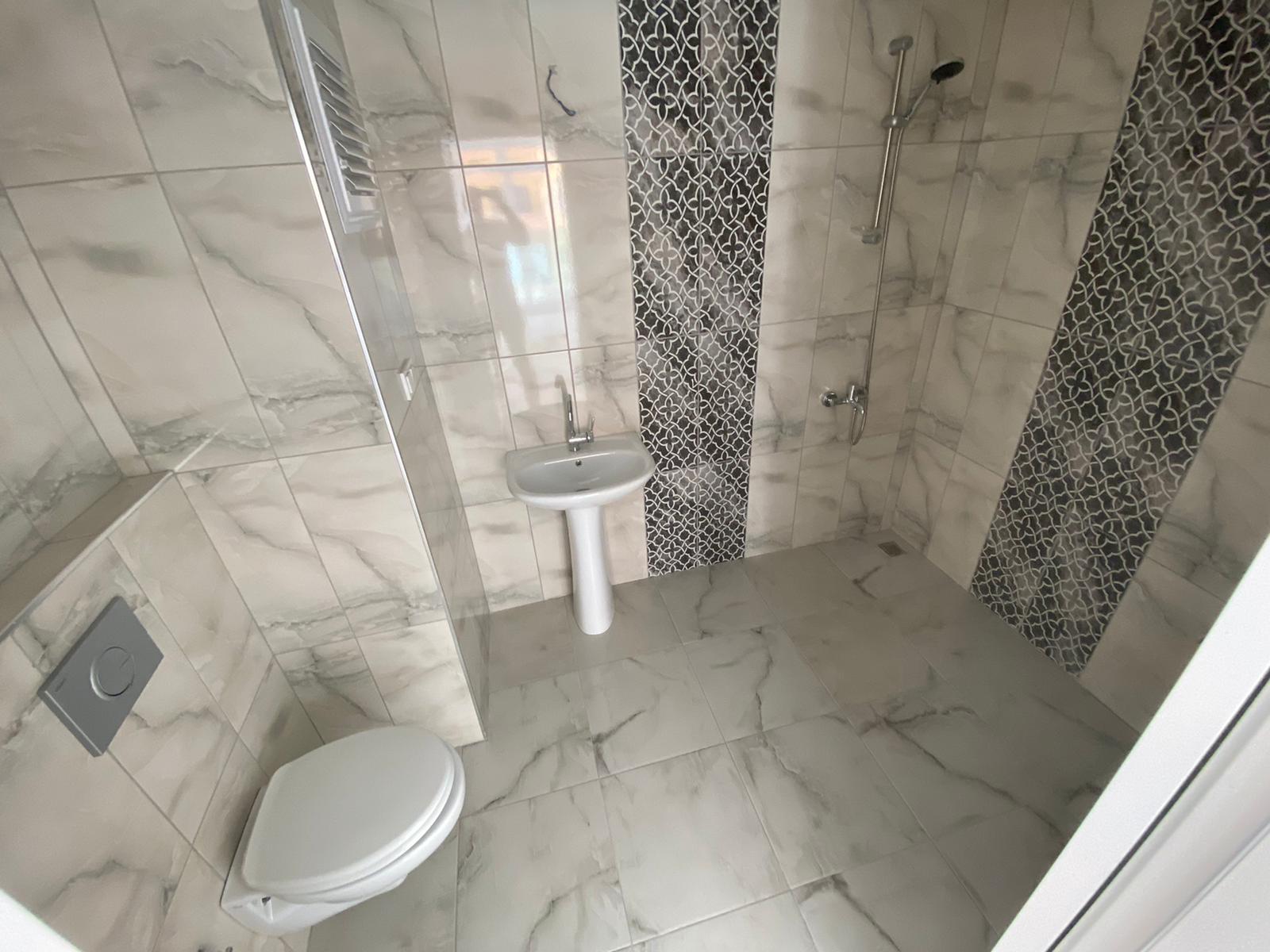Новая трехкомнатная квартира в Махмутларе