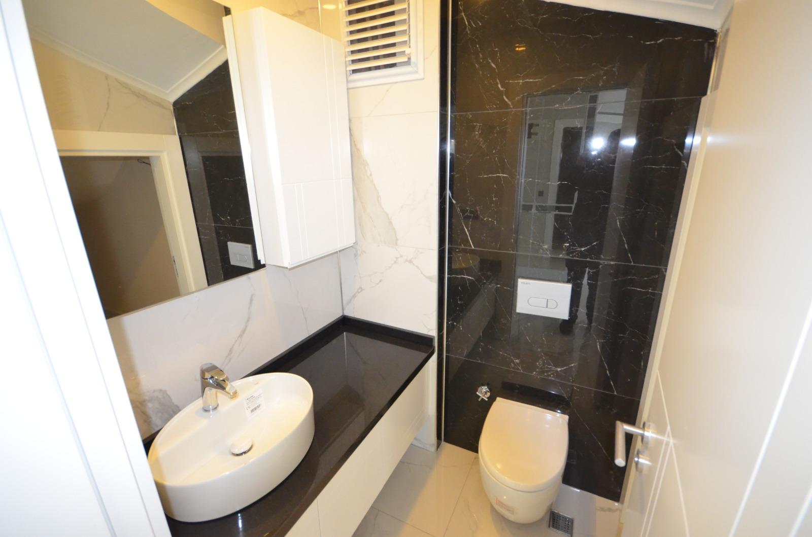 Алания Каргыжак  Квартира 3+1 в шикарном жилом комплексе на первой линии моря