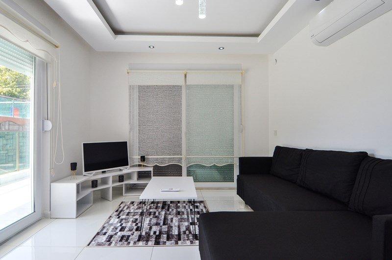 1+1 Меблированная уютная квартира на первом этаже с большим балконом