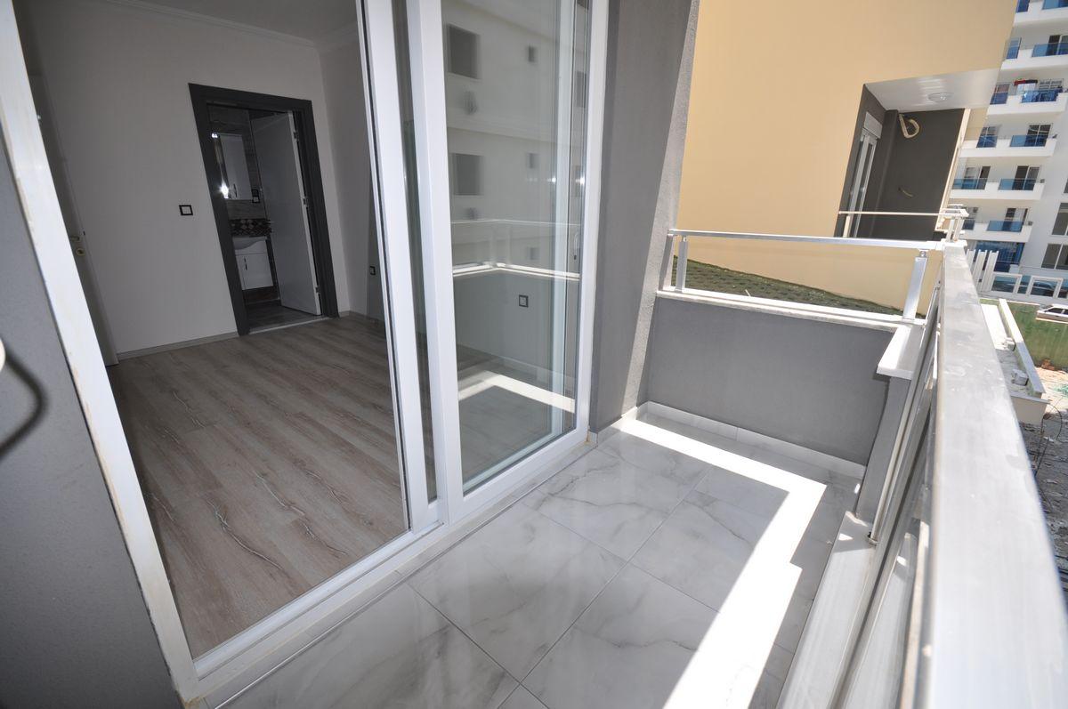 Двухкомнатная квартира в новом доме в Махмутларе