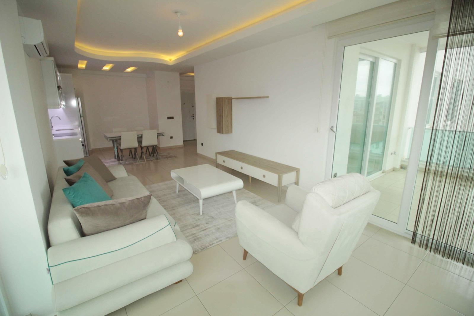 1+1 Меблированная квартира с видом на море в Тосмуре