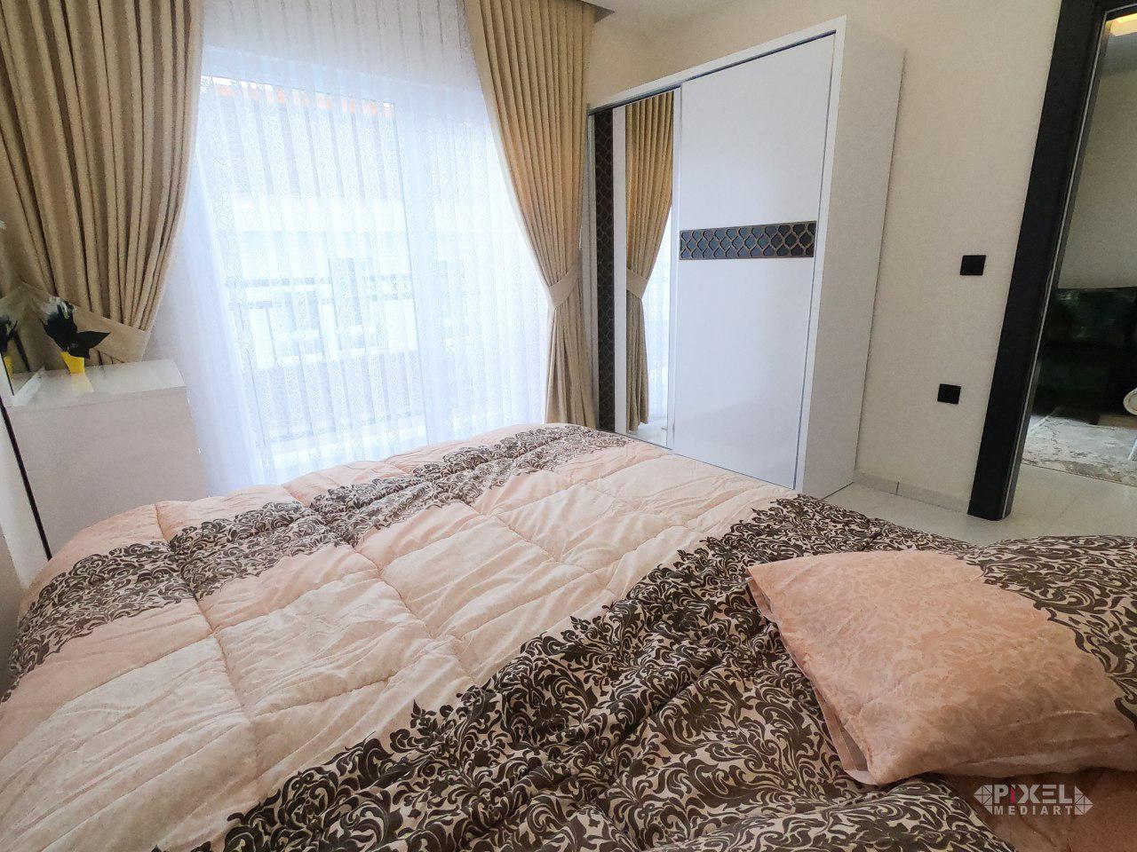 Двухкомнатная новая меблированная квартира в Махмутларе