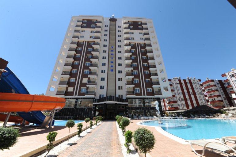 Меблированная 1+1 квартира в люкс резиденции на берегу моря