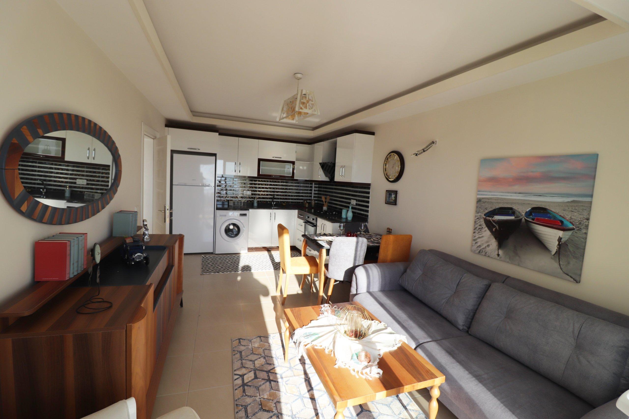 Новая меблированная 1+1 квартира на высоком этаже с панорамным видом на море