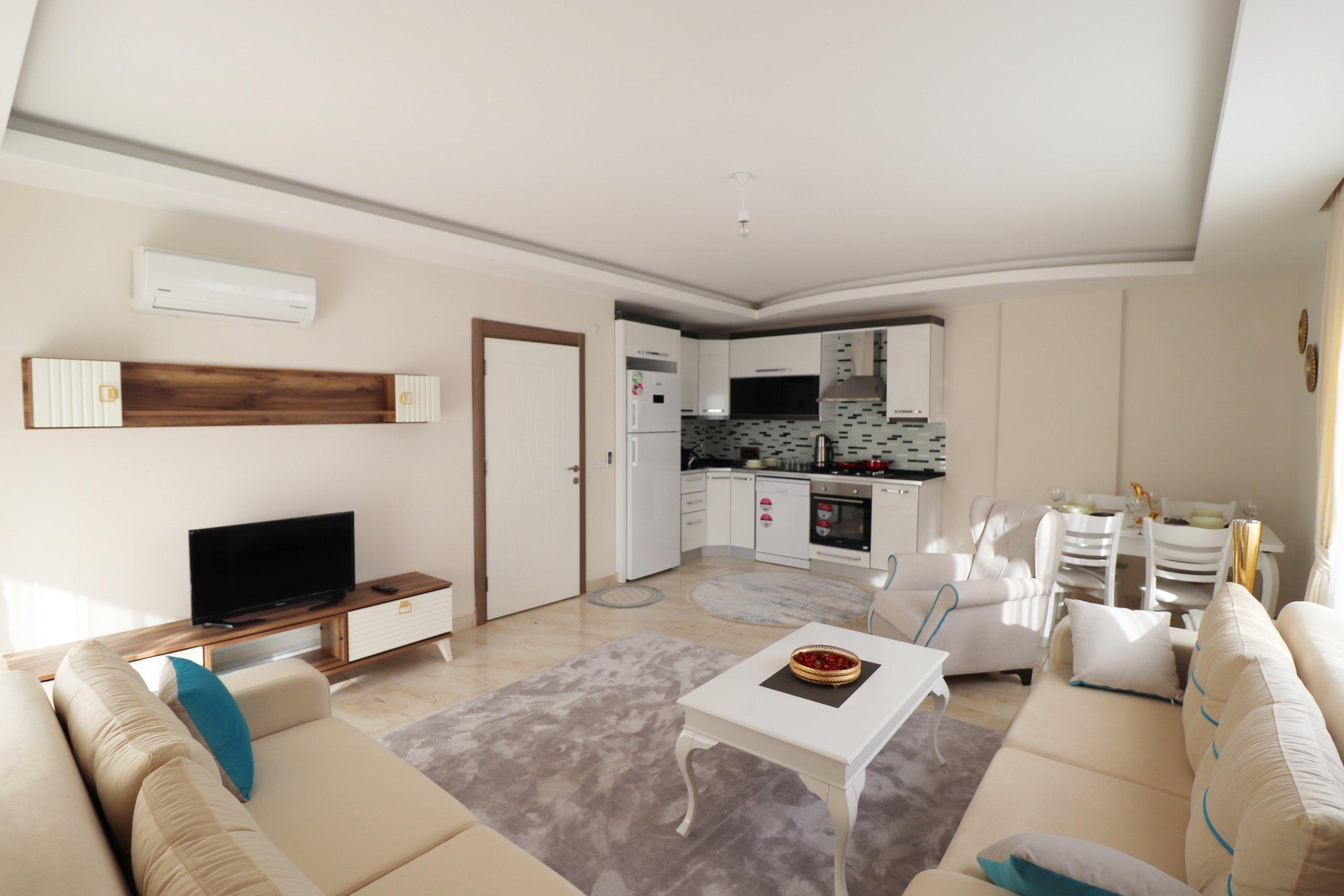 1+1 Новая меблированная квартира в Махмутларе