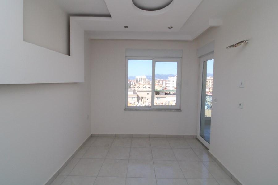 Двухкомнатная квартира на высоком этаже в Махмутларе