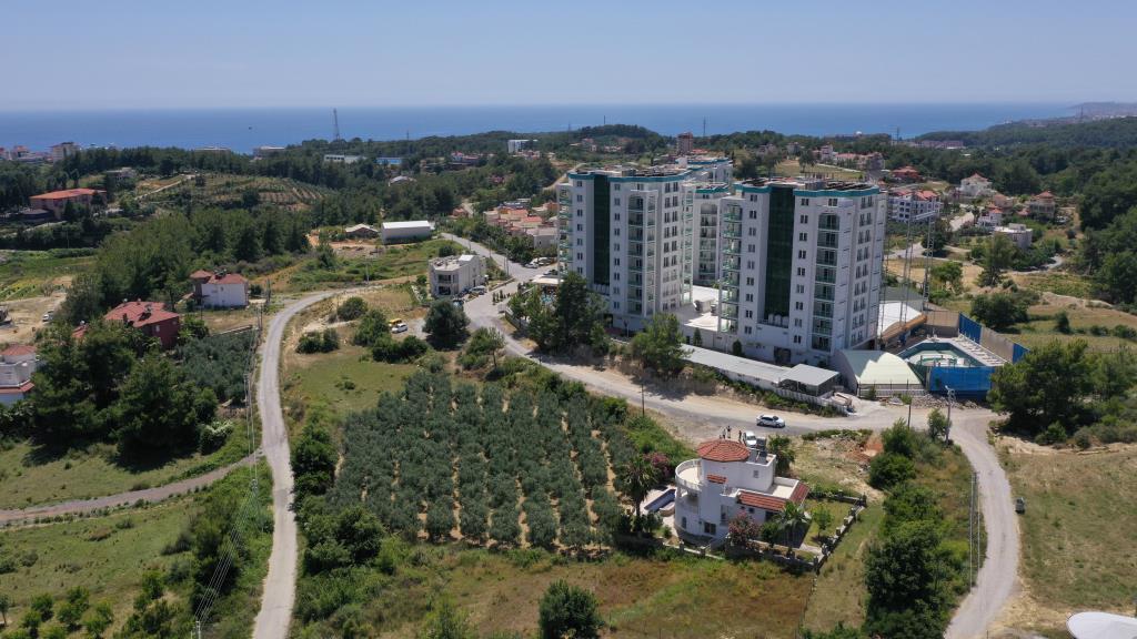 Трехэтажная 4+1 вилла с панорамным видом на море и горы в Авсаллар